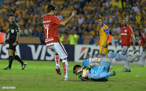 Nahuel Guzman of Tigres catches the ball while Nilmar of Internacional tries to score during a semifinal second leg match between Tigres UANL and...