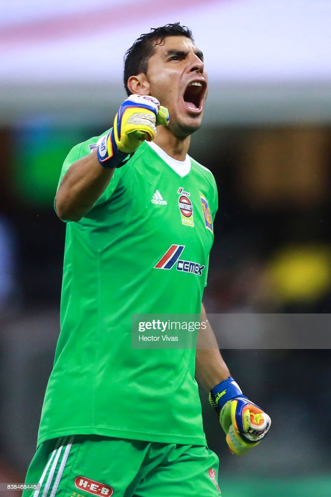 Nahuel Guzman of Tigres celebrates the second goal of his team scored by his teammate Alejandro Diaz (Not in Frame) during the 6th round match between America and Tigres UANL as part of the Torneo Apertura 2017 Liga MX at Azteca Stadium on August 23, 2017 in Mexico City, Mexico.