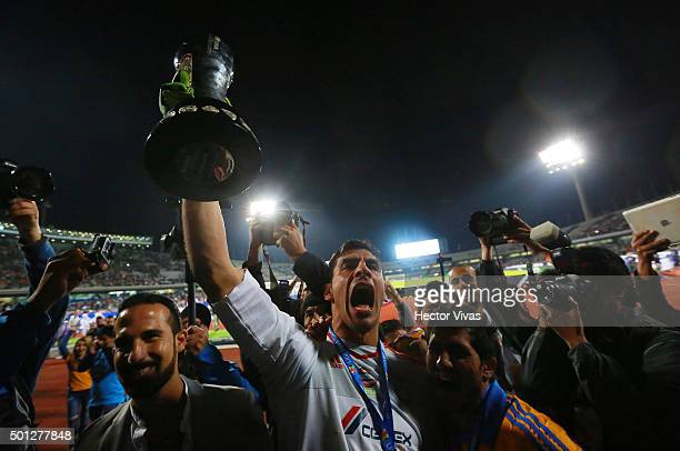 Nahuel Guzman of Tigres celebrates with the trophy after the final second leg match between Pumas UNAM and Tigres UANL as part of the Apertura 2015...