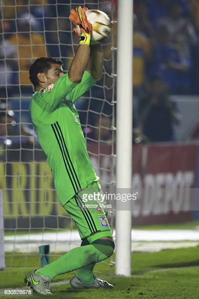 Nahuel Guzman of Tigres stops a penalty shot by Silvio Romero during the Final second leg match between Tigres UANL and America as part of the Torneo...