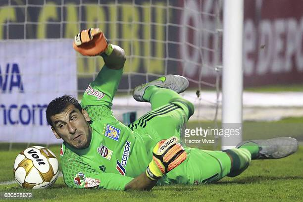 Nahuel Guzman of Tigres stops a penalty shot by William da Silva during the Final second leg match between Tigres UANL and America as part of the...