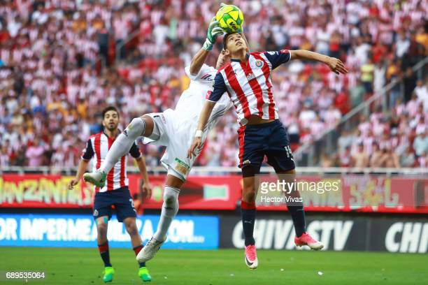 Nahuel Guzman of Tigres struggles for the ball with Angel Saldivar of Chivas during the Final second leg match between Chivas and Tigres UANL as part...