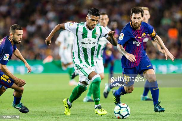 Nahuel Leiva of Real Betis and Lionel Messi of FC Barcelona during the match between FC Barcelona vs Real Betis Balompie for the round 1 of the Liga...