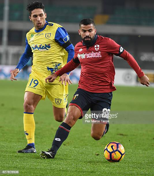 Nahuel Lucas Castro of AC ChievoVerona competes for the ball with Tomas Rincon of Genoa CFC during the Serie A match between AC ChievoVerona and...