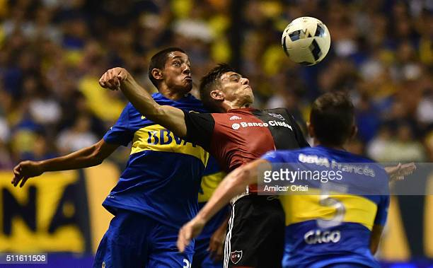 Nahuel Molina Lucero of Boca Juniors fights for the ball with Ignacio Scocco of Newell's during the 4th round match between Boca Juniors and Newell's...