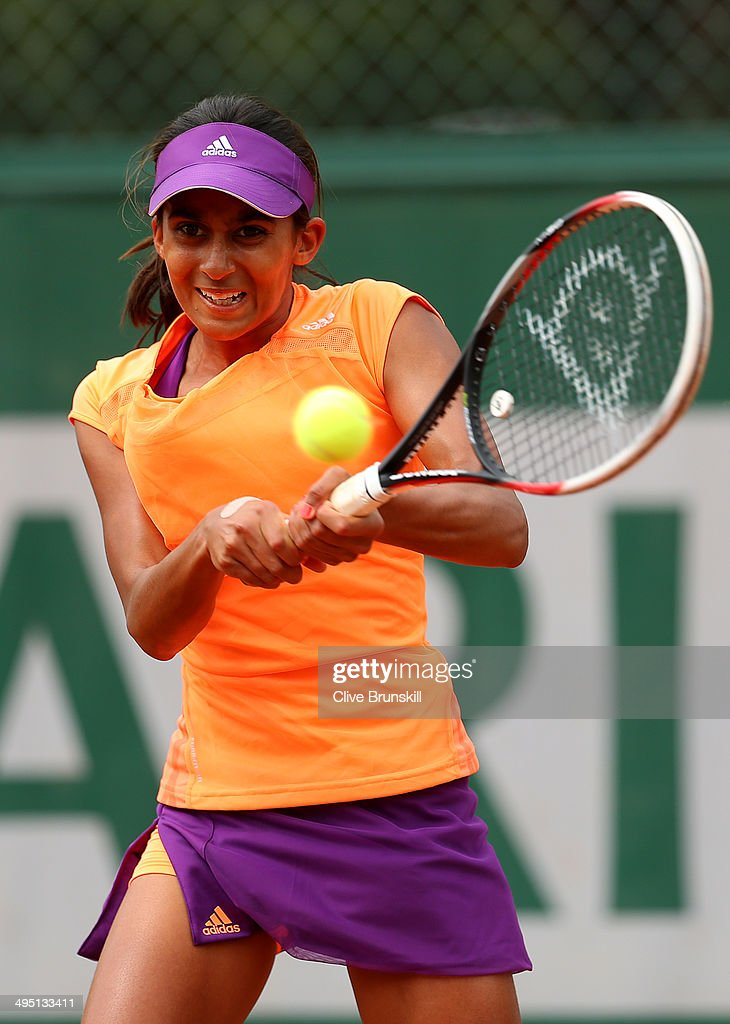 Naiktha Bains of Australia plays a backhand in her girls's singles match against Maria Fernanda Herazo Gonzalez of Colombia on day eight of the French Open at Roland Garros on June 1, 2014 in Paris, France.