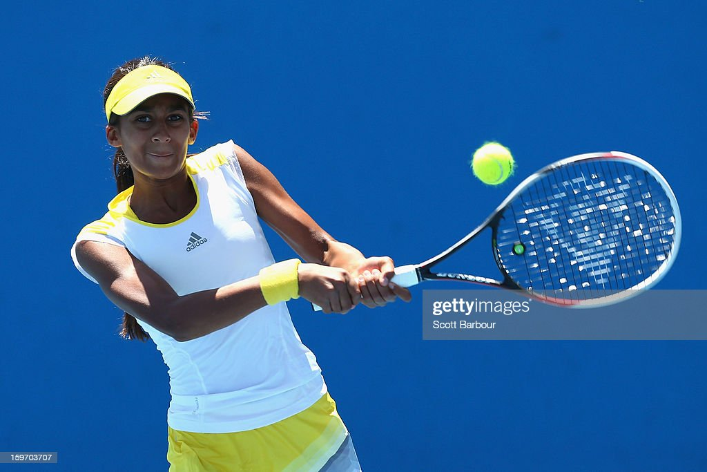 Naiktha Bains of Australia plays a forehand in her first round match against Olga Fridman of Ukraine during the 2013 Australian Open Junior Championships at Melbourne Park on January 19, 2013 in Melbourne, Australia.