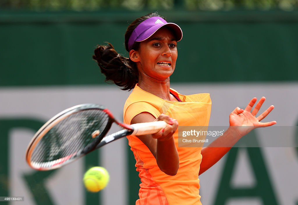 Naiktha Bains of Australia plays a forehand in her girls's singles match against Maria Fernanda Herazo Gonzalez of Colombia on day eight of the French Open at Roland Garros on June 1, 2014 in Paris, France.