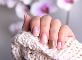 Nail design soft pink color.Winter manicure.