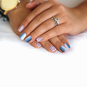 nail design with a monochrome gradient and polka dots in pastel shades