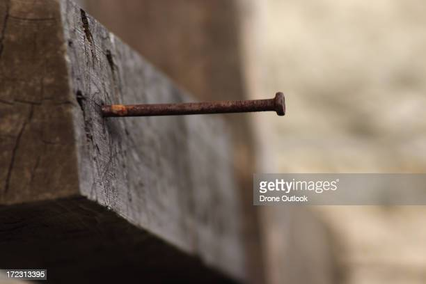 Nail in a wooden cross