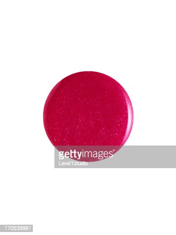 Nail polish droplet on white background
