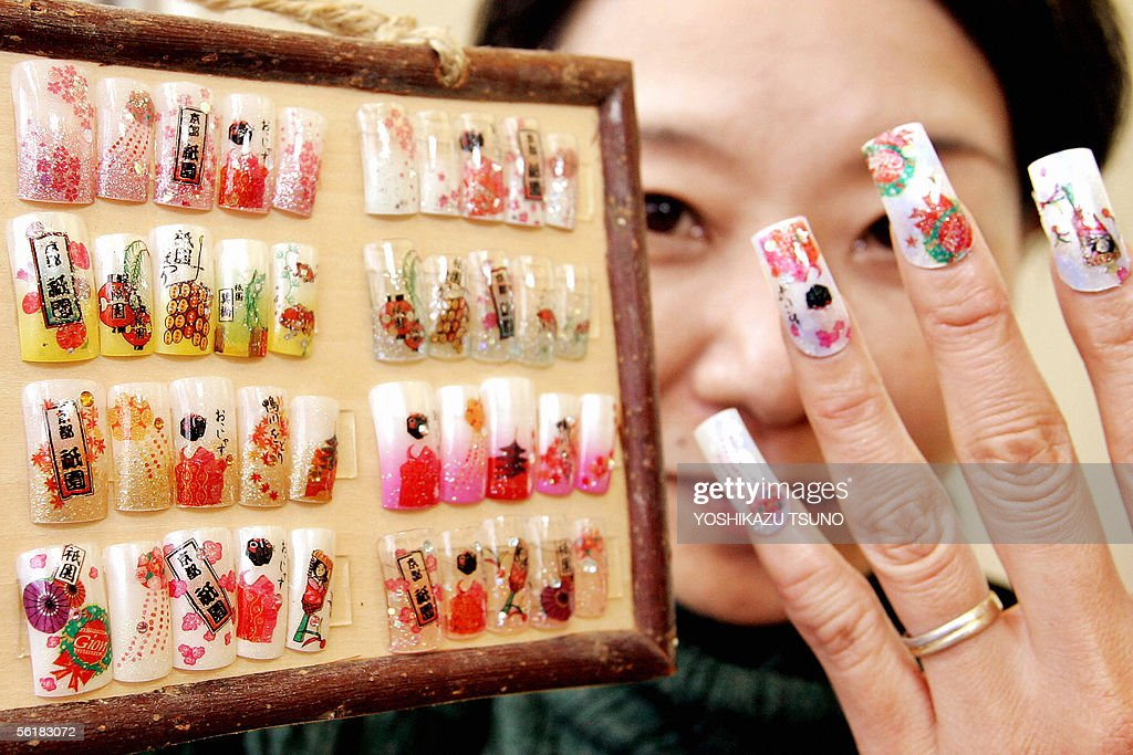 Nail salon manager displays its japanese acrylic nail art photos a nail salon manager kazumi nakagawa displays her japanese arcrylic nail art which is designed with prinsesfo Images