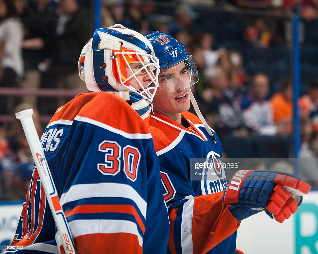 Nail Yakupov and Ben Scrivens of the Edmonton Oilers discuss play prior to a preseason game against the Vancouver Canucks on October 1 2015 at Rexall...