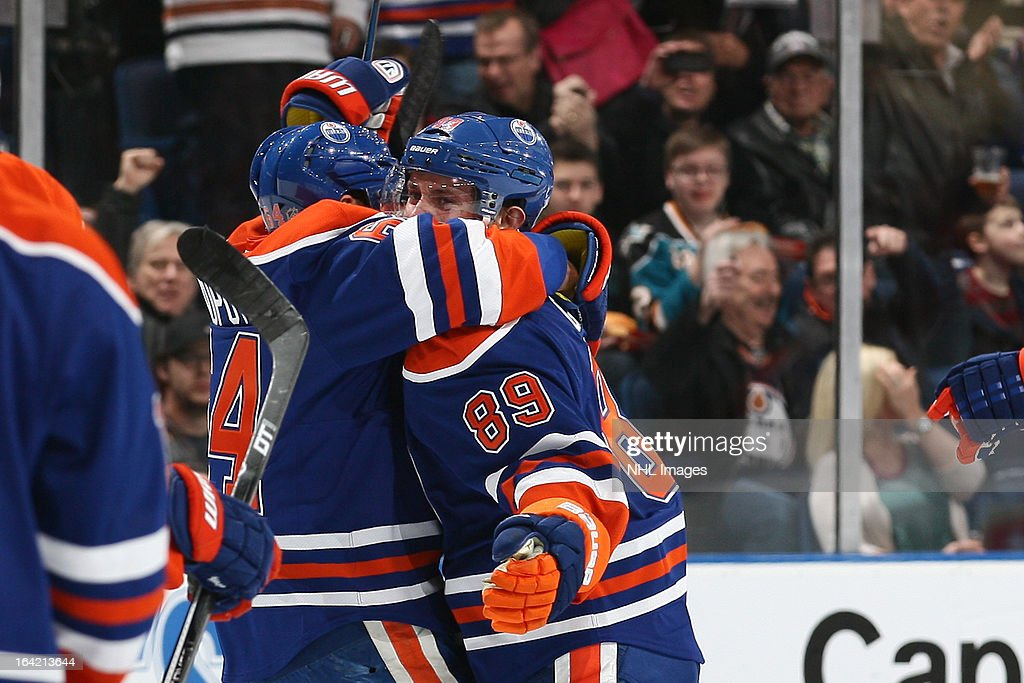 Nail Yakupov #64 and Sam Gagner #89 of the Edmonton Oilers celebrate after a first-period goal against the San Jose Sharks on March 20, 2013 at Rexall Place in Edmonton, Alberta, Canada.