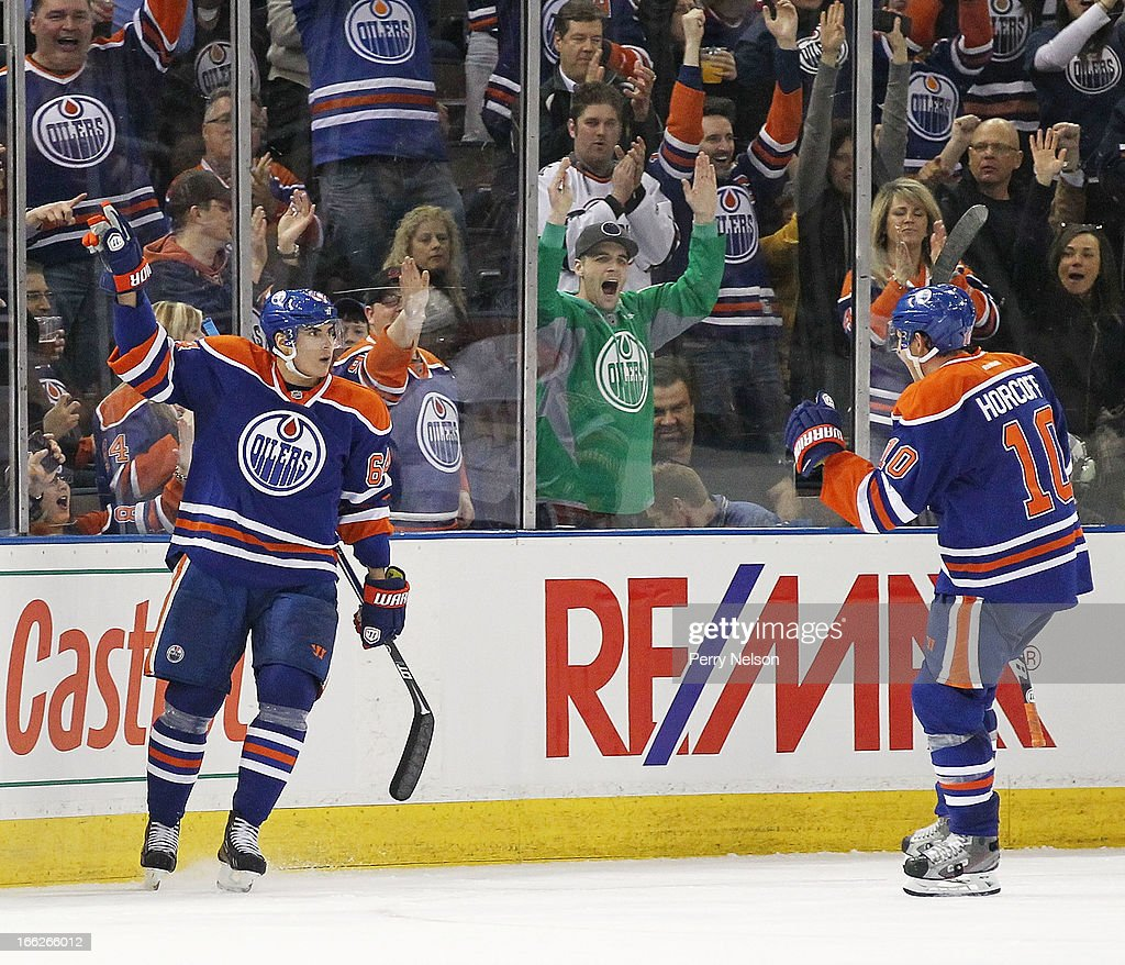 <a gi-track='captionPersonalityLinkClicked' href=/galleries/search?phrase=Nail+Yakupov&family=editorial&specificpeople=7419136 ng-click='$event.stopPropagation()'>Nail Yakupov</a> #64 and <a gi-track='captionPersonalityLinkClicked' href=/galleries/search?phrase=Shawn+Horcoff&family=editorial&specificpeople=239536 ng-click='$event.stopPropagation()'>Shawn Horcoff</a> # 10 of the Edmonton Oilers celebrate Yakupov's third period goal at Rexall Place on April 10, 2013 in Edmonton, Canada.
