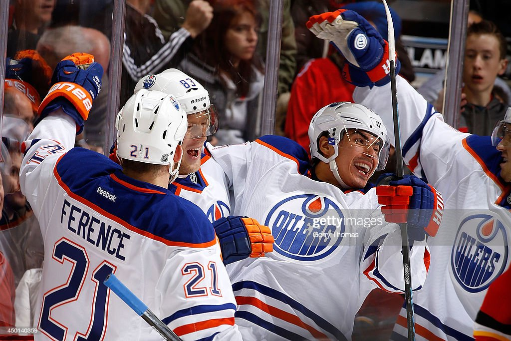 <a gi-track='captionPersonalityLinkClicked' href=/galleries/search?phrase=Nail+Yakupov&family=editorial&specificpeople=7419136 ng-click='$event.stopPropagation()'>Nail Yakupov</a> #64, <a gi-track='captionPersonalityLinkClicked' href=/galleries/search?phrase=Andrew+Ference&family=editorial&specificpeople=202264 ng-click='$event.stopPropagation()'>Andrew Ference</a> #21 and teammates of the Edmonton Oilers celebrate a goal against the Calgary Flames at Scotiabank Saddledome on November 16, 2013 in Calgary, Alberta, Canada.
