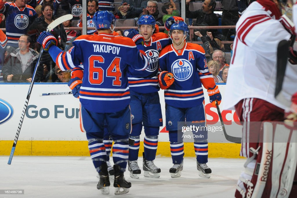 Nail Yakupov #64, Jordan Eberle #14 and Nick Schultz #15 of the Edmonton Oilers celebrate after scoring a goal in a game against the Phoenix Coyotes on February 23, 2013 at Rexall Place in Edmonton, Alberta, Canada.