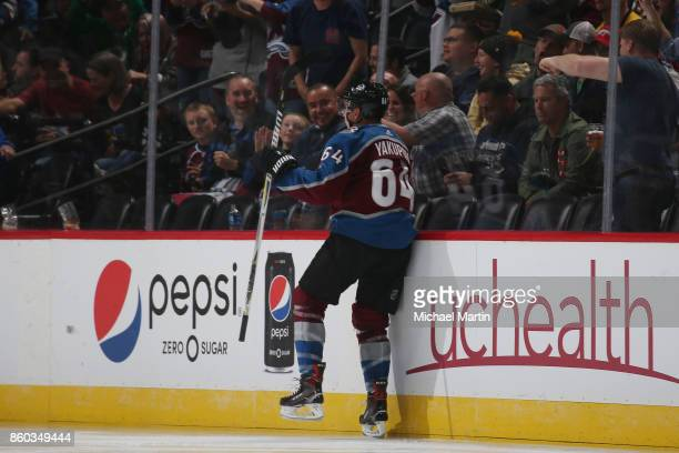 Nail Yakupov of the Colorado Avalanche jumps into the boards after scoring a goal against the Boston Bruins at the Pepsi Center on October 11 2017 in...