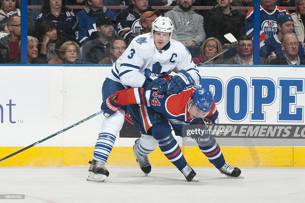 <a gi-track='captionPersonalityLinkClicked' href=/galleries/search?phrase=Nail+Yakupov&family=editorial&specificpeople=7419136 ng-click='$event.stopPropagation()'>Nail Yakupov</a> #64 of the Edmonton Oilers battles for position against <a gi-track='captionPersonalityLinkClicked' href=/galleries/search?phrase=Dion+Phaneuf&family=editorial&specificpeople=545455 ng-click='$event.stopPropagation()'>Dion Phaneuf</a> #3 of the Toronto Maple Leafs on October 29, 2013 at Rexall Place in Edmonton, Alberta, Canada.