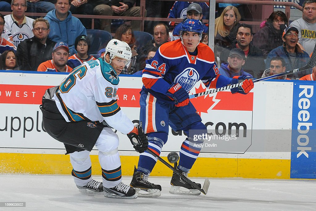 Nail Yakupov #64 of the Edmonton Oilers battles for position against Michal Handzus #26 of the San Jose Sharks at Rexall Place on January 22, 2013 in Edmonton, Alberta, Canada.