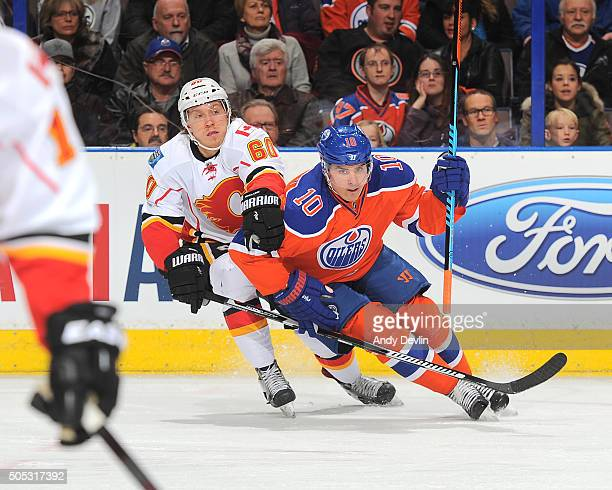 Nail Yakupov of the Edmonton Oilers battles for the puck against Markus Granlund of the Calgary Flames on January 16 2016 at Rexall Place in Edmonton...