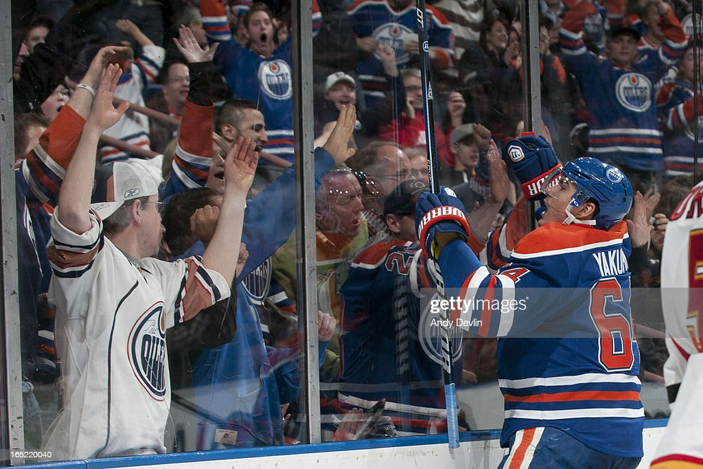<a gi-track='captionPersonalityLinkClicked' href=/galleries/search?phrase=Nail+Yakupov&family=editorial&specificpeople=7419136 ng-click='$event.stopPropagation()'>Nail Yakupov</a> #64 of the Edmonton Oilers celebrates a third period goal in a game against the Calgary Flames on April 1, 2013 at Rexall Place in Edmonton, Alberta, Canada.