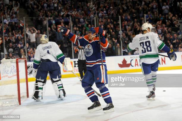 Nail Yakupov of the Edmonton Oilers celebrates his first hat trick as Roberto Luongo and Derek Joslin of the Vancouver Canucks turn their backs in...
