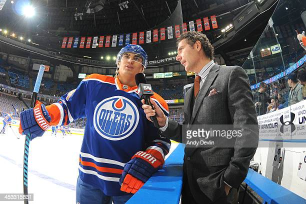 Nail Yakupov of the Edmonton Oilers does an interview with Sportsnet reporter Gene Principe prior to a game against the Columbus Blue Jackets on...