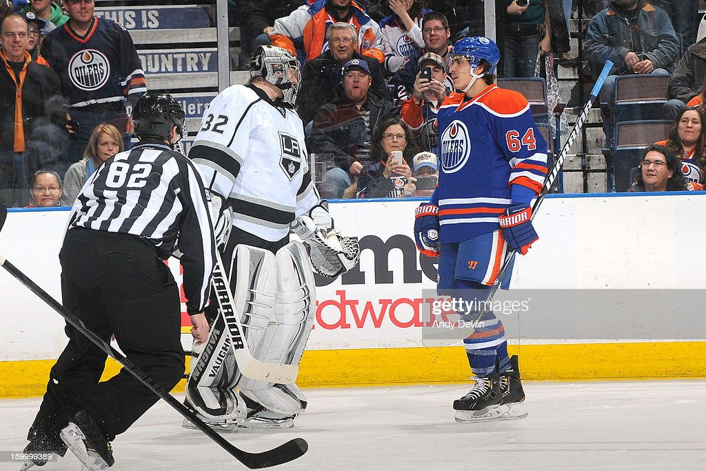 Nail Yakupov #64 of the Edmonton Oilers exchanges words with Jonathan Quick #32 of the Los Angeles Kings at Rexall Place on January 24, 2013 in Edmonton, Alberta, Canada.