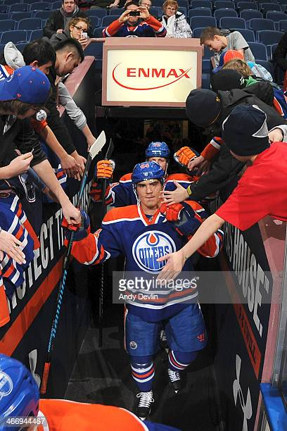 Nail Yakupov of the Edmonton Oilers greets fans as he makes his way to the ice prior to a game against the San Jose Sharks on January 29 2014 at...