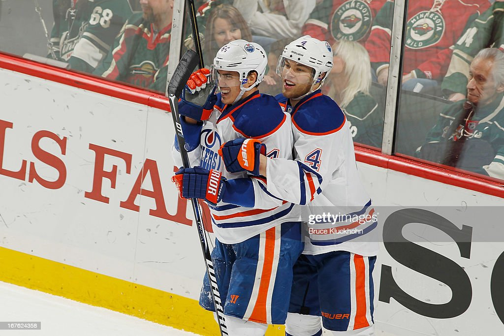 <a gi-track='captionPersonalityLinkClicked' href=/galleries/search?phrase=Nail+Yakupov&family=editorial&specificpeople=7419136 ng-click='$event.stopPropagation()'>Nail Yakupov</a> #64 of the Edmonton Oilers is congratulated by teammate <a gi-track='captionPersonalityLinkClicked' href=/galleries/search?phrase=Taylor+Hall&family=editorial&specificpeople=2808377 ng-click='$event.stopPropagation()'>Taylor Hall</a> #4 after scoring a goal against the Minnesota Wild during the game on April 26, 2013 at the Xcel Energy Center in St. Paul, Minnesota.