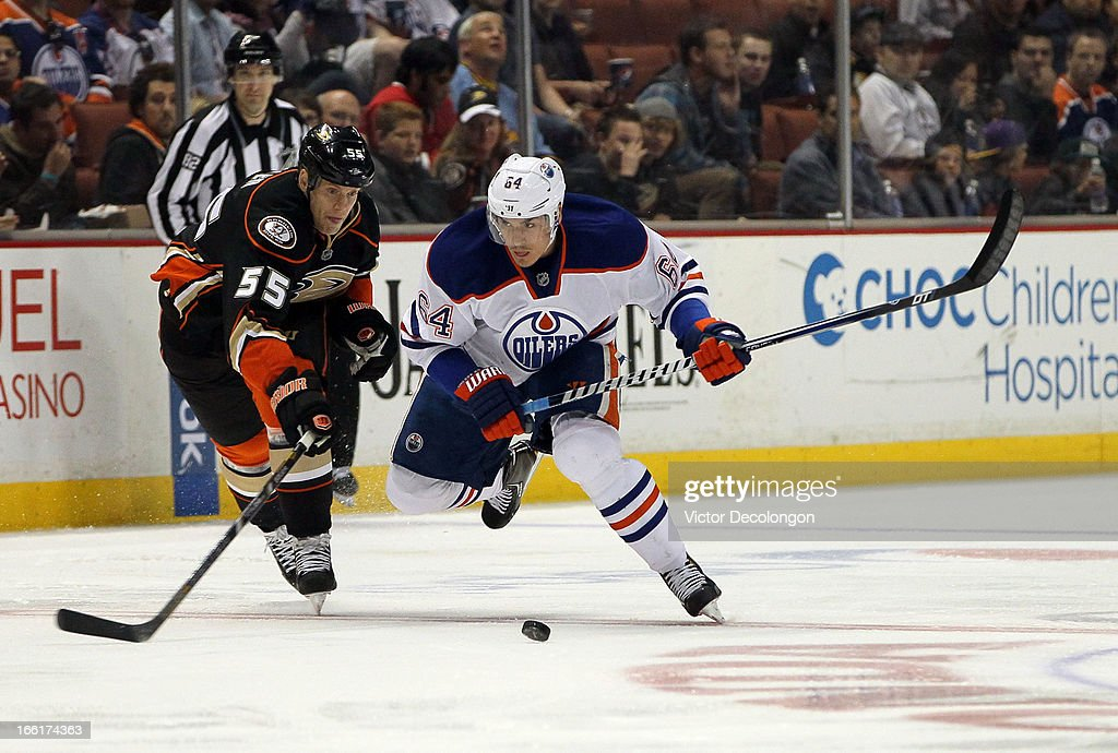 <a gi-track='captionPersonalityLinkClicked' href=/galleries/search?phrase=Nail+Yakupov&family=editorial&specificpeople=7419136 ng-click='$event.stopPropagation()'>Nail Yakupov</a> #4 of the Edmonton Oilers plays the puck through the neutral zone as <a gi-track='captionPersonalityLinkClicked' href=/galleries/search?phrase=Bryan+Allen+-+Ice+Hockey+Player&family=editorial&specificpeople=206454 ng-click='$event.stopPropagation()'>Bryan Allen</a> #55 of the Anaheim Ducks goes for the stick check in the second period during the NHL game at Honda Center on April 8, 2013 in Anaheim, California. The Ducks defeated the Oilers 2-1.