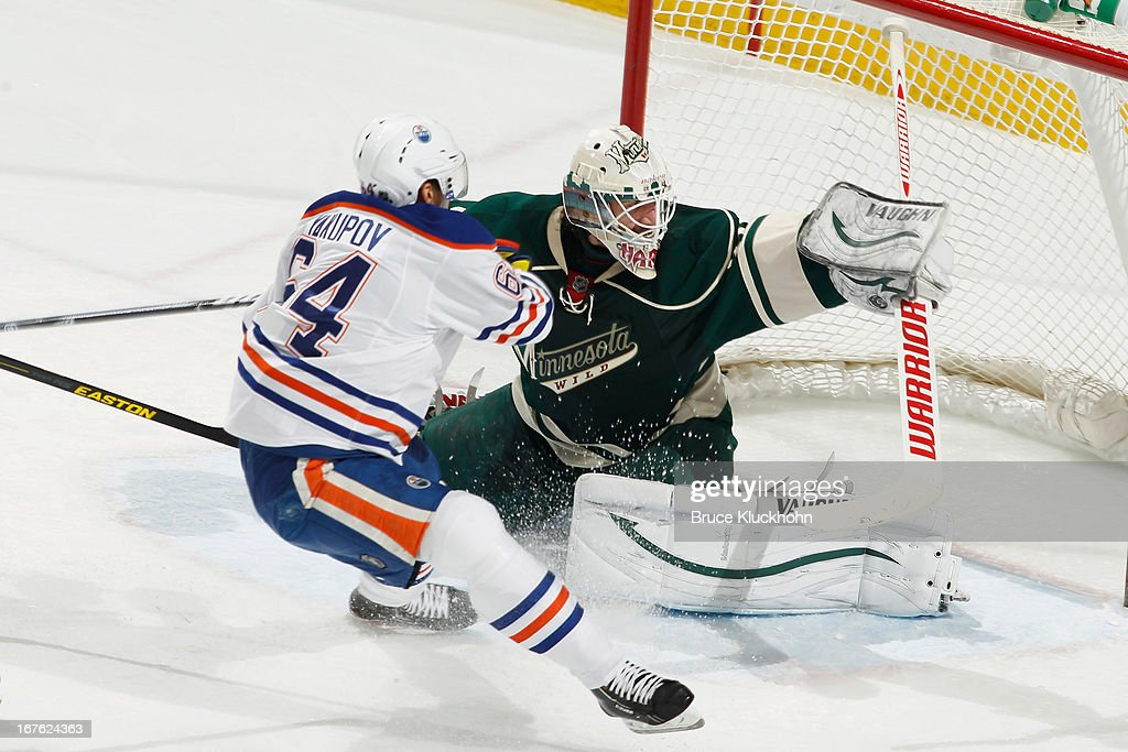 <a gi-track='captionPersonalityLinkClicked' href=/galleries/search?phrase=Nail+Yakupov&family=editorial&specificpeople=7419136 ng-click='$event.stopPropagation()'>Nail Yakupov</a> #64 of the Edmonton Oilers scores a goal against <a gi-track='captionPersonalityLinkClicked' href=/galleries/search?phrase=Josh+Harding&family=editorial&specificpeople=700587 ng-click='$event.stopPropagation()'>Josh Harding</a> #37 of the Minnesota Wild during the game on April 26, 2013 at the Xcel Energy Center in St. Paul, Minnesota.