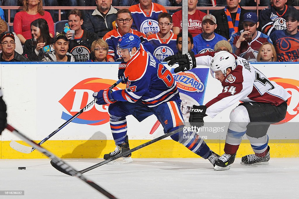 <a gi-track='captionPersonalityLinkClicked' href=/galleries/search?phrase=Nail+Yakupov&family=editorial&specificpeople=7419136 ng-click='$event.stopPropagation()'>Nail Yakupov</a> #64 of the Edmonton Oilers skates past David Jones #54 of the Colorado Avalanche during the NHL game at Rexall Place on February 16, 2013 in Edmonton, Alberta, Canada.