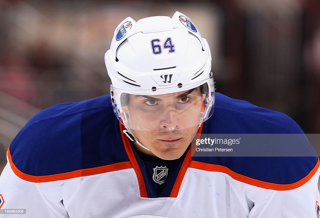 <a gi-track='captionPersonalityLinkClicked' href=/galleries/search?phrase=Nail+Yakupov&family=editorial&specificpeople=7419136 ng-click='$event.stopPropagation()'>Nail Yakupov</a> #64 of the Edmonton Oilers skates up to face off against the Phoenix Coyotes during the NHL game at Jobing.com Arena on October 26, 2013 in Glendale, Arizona. The Coyotes defeated the Oilers 5-4.