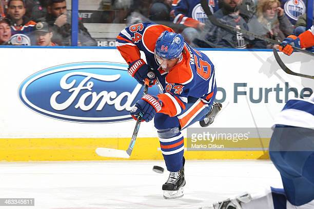 Nail Yakupov of the Edmonton Oilers takes a shot in a game against the Tampa Bay Lightning on January 5 2014 at Rexall Place in Edmonton Alberta...