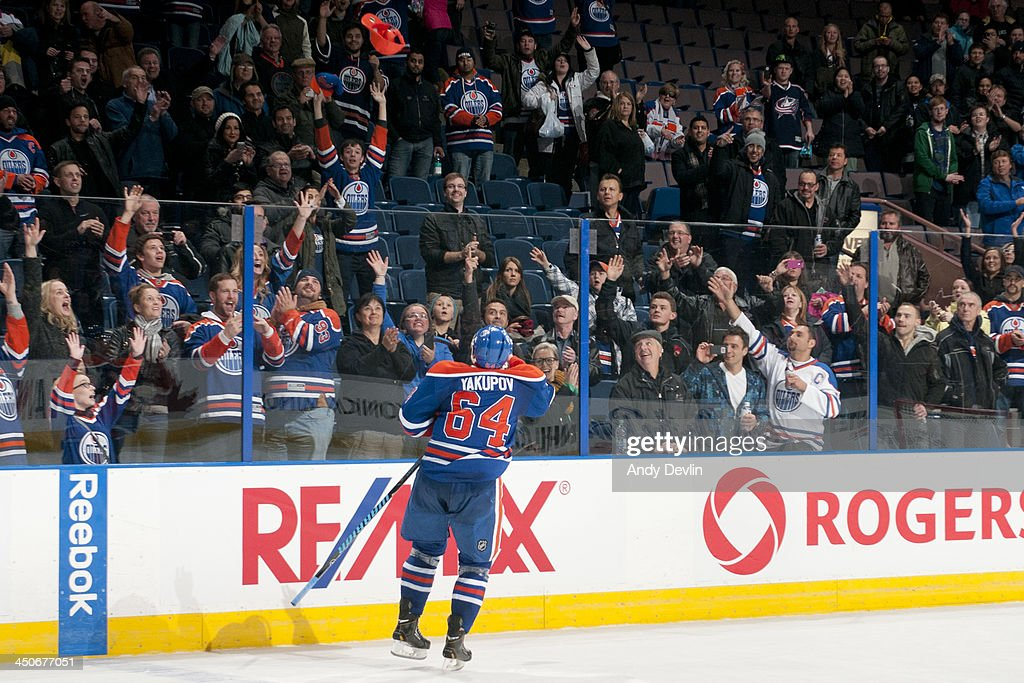 <a gi-track='captionPersonalityLinkClicked' href=/galleries/search?phrase=Nail+Yakupov&family=editorial&specificpeople=7419136 ng-click='$event.stopPropagation()'>Nail Yakupov</a> #64 of the Edmonton Oilers tosses a hat into the crowd after being selected as the second star of the game against the Columbus Blue Jackets on November 19, 2013 at Rexall Place in Edmonton, Alberta, Canada.