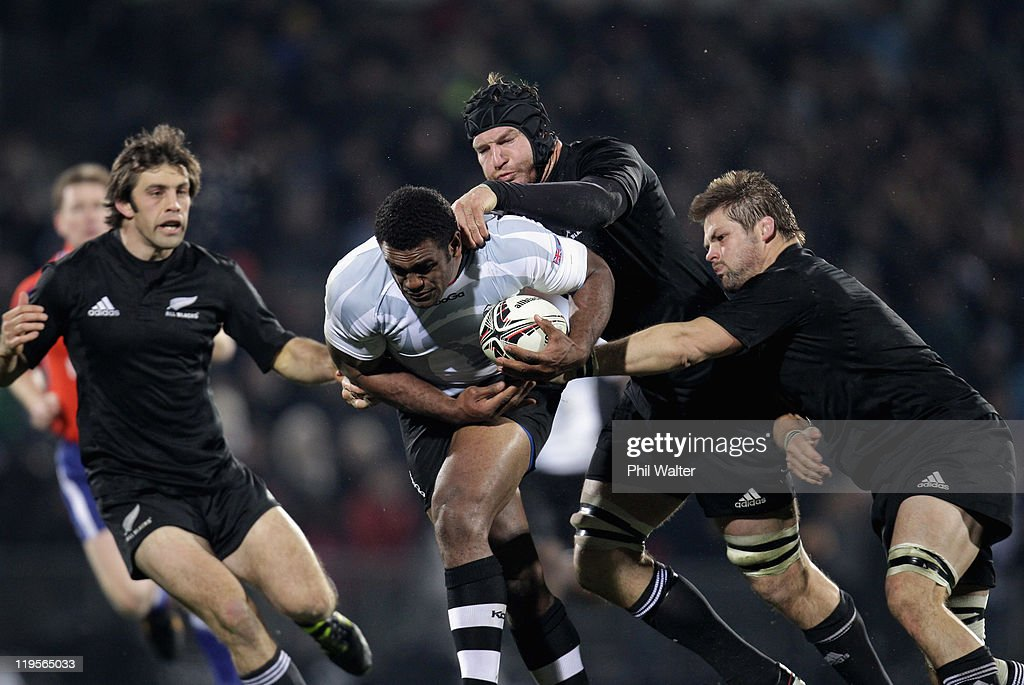 Naipolioni Nalaga of Fiji is tackled by Ali Williams and Richie McCaw of the All Blacks during the International Test match between the New Zealand All Blacks and Fiji at Carisbrook on July 22, 2011 in Dunedin, New Zealand.