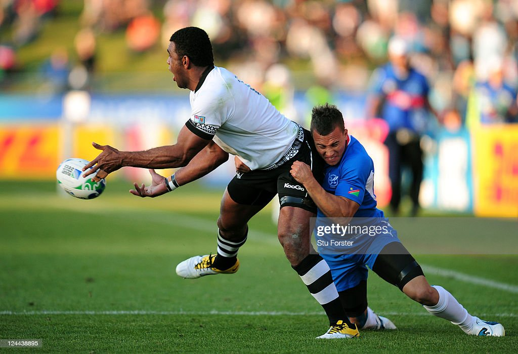Naipolioni Nalaga of Fiji offloads as he is tackled by Llewellyn Winkler of Namibia during the IRB 2011 Rugby World Cup Pool D match between Fiji and Namibia at Rotorua International Stadium on September 10, 2011 in Rotorua, New Zealand.