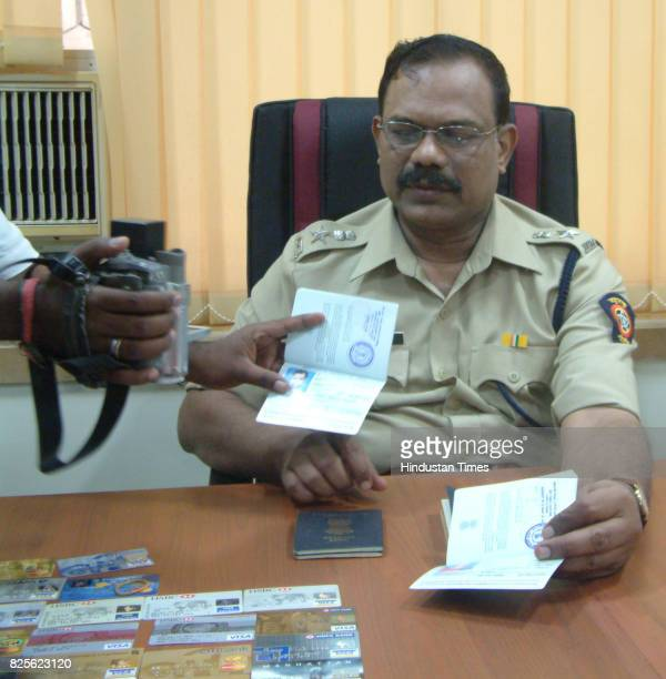 DCP Ajit Patil with the Credit cards Mobile phones and Passport recovered from the flat where the nair family allegedly committed suicide due to...