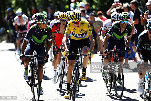 Nairo Alexander Quintana of Colombia riding for Movistar Team eyeballs Chris Froome of Great Britain riding for Team Sky in the yellow leaders jersey...