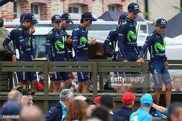 Nairo Quintana leads his Movistar team off a first world war military vehicle as they arrive for the team presentations on June 30 2016 in...