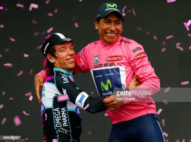Nairo Quintana of Colombia and team Movistar embraces fellow Colombian Rigoberto Uran of team Omega PharmaQuickStep following the twentyfirst stage...