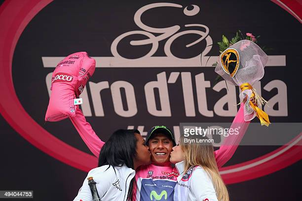 Nairo Quintana of Columbia and Movistar Team celebrates taking the overall leader's Maglia Rosa 'pink jersey' on the podium after winning the...