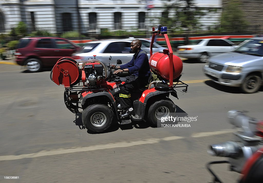A Nairobi Fire Brigade serviceman rides a Fire Fighting All-Terrain-Vehicle (ATV) on December 11, 2012 in Nairobi which is the latest effort by the East African nation's government to beef up it's preparedness to respond to and curb fire, particularly in slums where fire outbreaks have in recent years claimed numerous lives and property due to their unregulated rapid growth making them less accessible to traditional fire fighting engines. At least 120 people burned to death when a pipeline burst into flames in a Nairobi slum in September 2011 as local people were siphoning fuel from it, and more than 100 were injured. AFP PHOTO/Tony KARUMBA