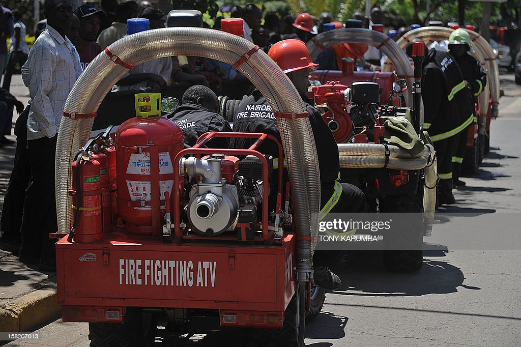 Nairobi Fire Brigade servicemen sit on their Fire Fighting All-Terrain-Vehicles (ATV) on December 11, 2012 in Nairobi which is the latest effort by the East African nation's government to beef up it's preparedness to respond to and curb fire, particularly in slums where fire outbreaks have in recent years claimed numerous lives and property due to their unregulated rapid growth making them less accessible to traditional fire fighting engines. At least 120 people burned to death when a pipeline burst into flames in a Nairobi slum in September 2011 as local people were siphoning fuel from it, and more than 100 were injured. AFP PHOTO/Tony KARUMBA