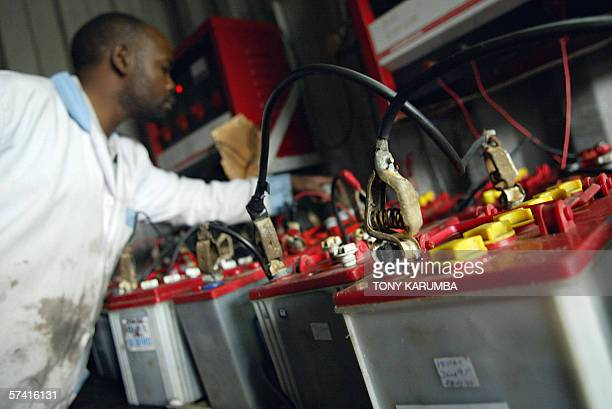 A secondhand batteries vendor collects 18 April 2006 used cells for export to Chinese and Indian car battery manufacturers which extract lead...