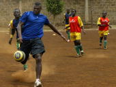 French football player Marcel Dessailly plays football with children at Mathare Kenya's largest slum at their rehabilitation center 25 October 2006...