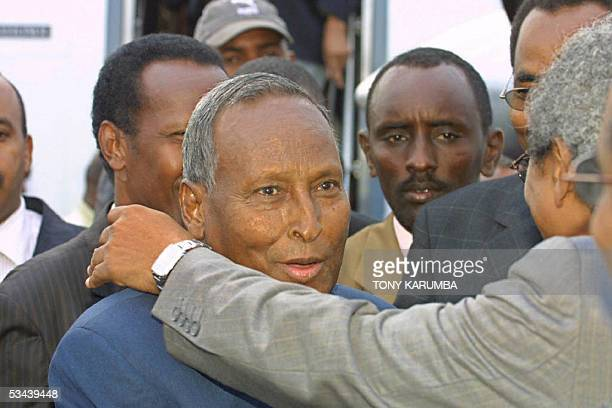 Somali president Abdullahi Yusuf is greeted by members and supporters of his government 19 August 2005 in Nairobi soon after his arrival The interim...